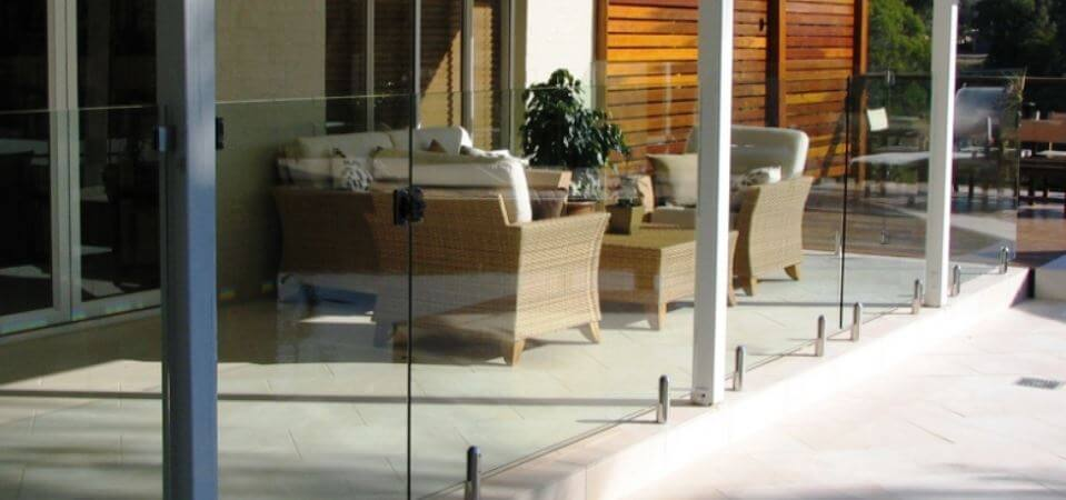 glass balustrades protecting a pool